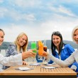 Women toasting cocktails outdoor restaurant terrace — Stock Photo