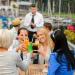 Women celebrating with cocktails at restaurant — Stockfoto