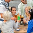 Group of cheerful toasting with cocktails — Stock Photo