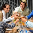Group of cheerful toasting with drinks — Photo