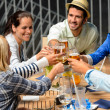 Group of cheerful toasting with drinks — Stok fotoğraf