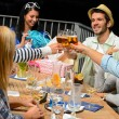 Young people celebrating birthday toasting - Stock Photo