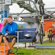 Happy couple traveling chair lift enjoying landscape - Stock Photo