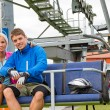 Stock Photo: Young couple sitting chair lift waiting departing