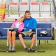 Cuddling couple sitting chair lift with bicycles - Foto Stock