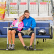 Cuddling couple sitting chair lift with bicycles - ストック写真