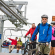Couple getting on bicycles chair lift trip — Stock Photo #22893404