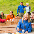 Friends having fun rest area drinking refreshments — Stock Photo