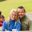 Smiling young couple outdoors resting weekend — Stock Photo