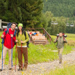 Hiker couples following path on mountain - Stock Photo