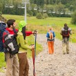 Hiking friends pointing and walking on path — Stock Photo