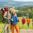 Royalty-Free Stock Photo: Posing hiker couple with landscape background