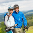 Sporty couple enjoying fresh air bicycles nature - Stock Photo