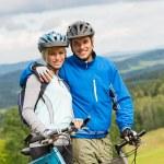 Sporty couple enjoying fresh air bicycles nature — Stock Photo