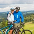 Young cyclists with mountain bikes during summer weekend — Stock Photo