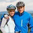 Young sporty couple with mountain bikes in helmet — Stock Photo