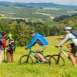 People hiking, riding bicycles on springtime weekend - Stock Photo