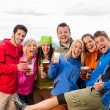 Posing smiling young with beer outdoors — Stock Photo