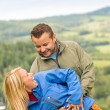 Smiling young couple posing outdoors — Stock Photo