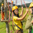 Stock Photo: Young couple in safety equipment adventure park