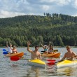 Waving cheerful friends in kayaks summer — Stock Photo