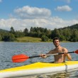 Sporty man in kayak with oar summer — Stock Photo #22893944