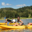 Young people sunbathing on kayak - Stock Photo