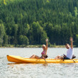 Man and woman kayaking on pond vacation — Stock Photo