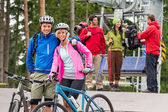 Mountain bikes couple and hikers after chair lift — Stock Photo