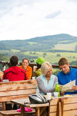 Young couple read map mountain bikers sport — Stock Photo