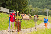 Hiker couples following path on mountain — Stock Photo
