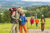 Posing hiker couple with landscape background — Stock Photo
