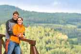 Loving couple on romantic summertime weekend hill — Stock Photo