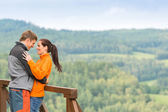 Smiling couple hugging outdoors nature background — Stock Photo