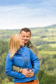 Lovely young couple hugging with scenic view — Stock Photo
