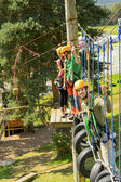 Climbing visitors in adventure park — Stock Photo