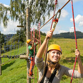 With ropes in adventure park — Stock Photo