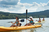 Young students kayaking in the sunshine — Stock Photo