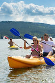 Smiling couple rowing kayak sunshine — Stock Photo