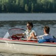 Men driving speed boat enjoying sunshine — Stock Photo #23390860