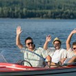 Cheerful young guys partying in speed boat — Stok fotoğraf