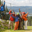 Happy hikers reaching their goal mountain top — Stock Photo