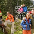 Hikers and cyclists on summer vacation - Stock Photo