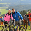 Stock Photo: Sporty cyclist couple hikers springtime weekend
