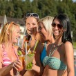 Young women in bikini partying with cocktails - Stock Photo