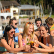 Beautiful women in bikinis toasting with cocktails — Stock Photo