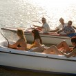 Stock Photo: Young driving motorboats summer lake