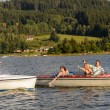 Young friends having fun in motorboats — Stock fotografie