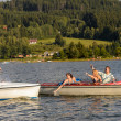 Young friends having fun in motorboats — Stock Photo #23391114
