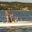 Young friends enjoying summer on speed boat — Stock Photo #23391130